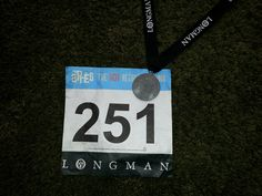 My cool medal and race number from the Longman 10K. 2014