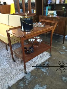Mid century modern Danish style teak bar cart with removable serving tray. Available at Mid Mod Collective. Email midmodcollective@gmail.com for more info. SOLD!