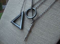 Hey, I found this really awesome Etsy listing at https://www.etsy.com/listing/199584795/the-deathly-hallows-friendship-necklace
