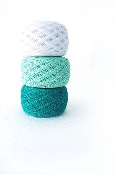Linen Yarn,  set of 3 balls, natural linen thread, green, mint green, snow white. $21.00, via Etsy.