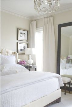 Our Bedroom : white chesterfield headboard, black brown bedsides and mirror with white on white bedding, love the pics above the bedside tables