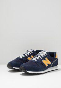 New Balance 373 - Zapatillas - blue/yellow/azul marino - Zalando ...