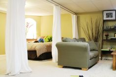 Sliding Curtain Room Dividers. I have to find a cheap way to do this for our room, it's perfect!