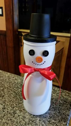 Our puffs container snowman. Used a recycled kcup that I painted black as the hat.