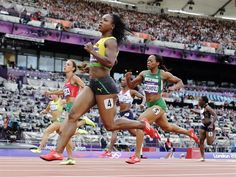Day 7: Track & Field Evening Session - Track & Field Slideshows | Jamaica's Veronica Campbell-Brown, foreground, crosses the finish line ahead of Bulgaria's Ivet Lalova, left, and Nigeria's Gloria Asumnu in a women's 100-meter heat during the athletics in the Olympic Stadium at the 2012 Summer Olympics, London, Friday, Aug. 3, 2012. (AP Photo/David J. Phillip )  #NBCOlympics