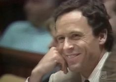 Gif of serial killer Ted Bundy in court. He looks so uncomfortable..