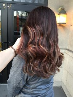 Burgundy and caramel balayage on brunette hair by @amy_ziegler
