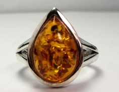 ATTRACTIVE NATURAL BALTIC AMBER RING SIZE 9 MGMG198  ORIGIN: POLAND   AMBER SIZE: 15X10 MM  TOTAL CARAT WEIGHT    33.5CTS  METAL:  JEWELLERY IS STERLING SILVER  SETTING RING: STAMPED HALLMARK 925