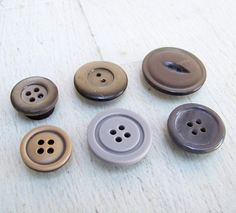 Buttons into magnets. Love this.