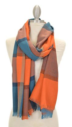 Long, soft scarf with an oversized plaid pattern. $22 at shopbluedoor.com