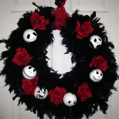 I made it by wrapping a grapevine wreath with a black boa, sticking some red roses in there. I painted the ornaments. I am thinking of putting a big red bow on top.
