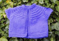Baby Cardigan with Garter Ridges - Keep your toddler warm with this Baby Cardigan with Garter Ridges. Learn how to knit a sweater that is cute and cozy for your toddler. It is one of the easiest free knitting patterns you will find and is perfect for beginners with the garter stitch edges. This is a fantastic baby sweater knitting pattern because of how adorable and convenient it is. The easy slip-on design makes this cardigan great for travel or playing outside.