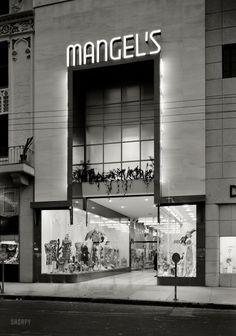 "January 21, 1942. ""Mangel's, 130 E. Flagler Street, Miami, Florida. Exterior, night. Ross-Frankel Inc., client; Morris Lapidus, architect."" Note the ghost pedestrians."