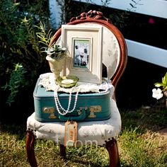 Vintage Wedding Decor-antique cases, frames and furniture at the entrance to the reception hall