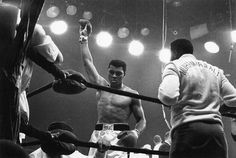 Boxing great Muhammad Ali stands victorious over Sonny Liston