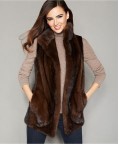 The Fur Vaults luxuriously soft mink vest makes a sumptuous top layer for falls textured knits and leather jackets. | Real mink fur; lining: polyester | Professional fur clean only | Imported | Genu