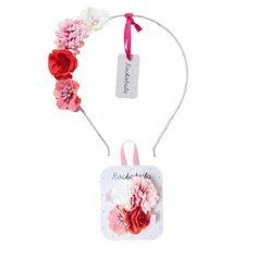 This vibrant Rockahula Kids' gift set comprises a gorgeous pair of grosgrain ribbon-covered clips and a matching Alice band, each adorned with clusters of flowers. Perfect for flower girls or to help celebrate any special occasion.