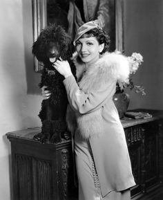 Claudette Colbert with her French Poodle pet, Smokey