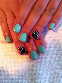 GEL NAILS, a thick gel nail polish which is cured (heated for adhearance) with an ultraviolet light. Lasts 2-3 weeks... Here, Teal & Black Gel Nails