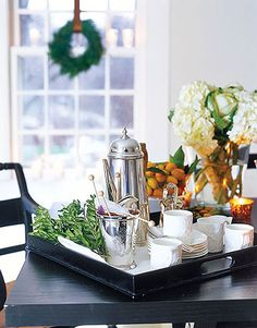 Tea Service For post-dinner coffee and tea, organize cups and saucers along with fun additions like sugar sticks, fresh herbs, or candy canes for a peppermint kick. #Christmas #holidays Read more: Christmas Table Settings - Centerpiece Ideas for Christmas Table - Country Living