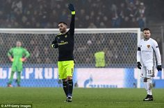 The 27-year-old Arsenal striker celebrates completing his 47-minute treble atSt Jakob Park
