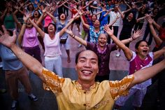 [series by Dominic Blewett] Laugh your way to a healthy life with 'Laughing Yoga.' Early morning session in front of Ly Thai To statue in Hanoi, Vietnam