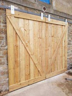Sliding Garage Doors, Carriage Garage Doors, Barn Garage, Wooden Barn Doors, Diy Barn Door, Barn Door Hardware, Making Barn Doors, Building A Barn Door, Exterior Barn Doors