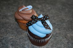 Baby Boy Shower Cupcakes. Gonna be quite honest the chocolate one looks like a pile of poop on top! Haha! Which is keeping with the baby motif!