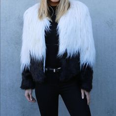 Faux fur dip dyed jacket Fun outgoing faux fur jacket with a white and dip dye black blend. This is NWT in perfect condition. Fits a size small to small medium. Tag says XL but I promise it doesn't fit anywhere near that Jackets & Coats
