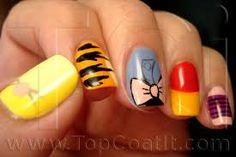 Winnie The Pooh Nails. I want the Eeyore tail!!!
