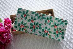 box of miniature christmas decorations