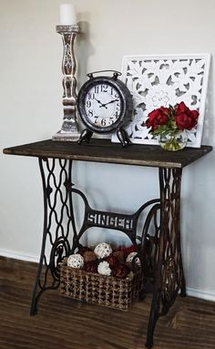 This vintage singer machine table has been crafted into a one of a kind end table that is a unique conversational piece of statement furniture for the living room, reading room, or bedroom. I love the historical vibes this piece brings to a loving area. I dressed it up with modern decor to get a
