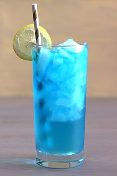 The Blue Devil Cocktail is made with blue Curacao and rum. A perfect summer cocktail.This blue curacao cocktail recipe is a favorite summer cocktail recipe. Blue Drinks, Beach Drinks, Summer Drinks, Blue Curacao Drinks, Beach Alcoholic Drinks, Colorful Drinks, Drinks With Peach Schnapps, Simple Vodka Cocktails, Drinks With Coconut Rum