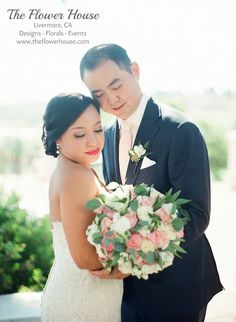 Groom wore a white freesia, eucalyptus boutonniere