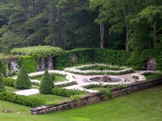 Formal Parterre Courtyard with White Astilbe, Hemlock Hedges, and Clipped Arbor Vitae Surrounded by Stone Walls at The Mount, Edith Wharton's Berkshires Home
