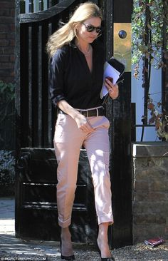Kate Moss steps out in a pair of pretty pastel trousers for lunch date.