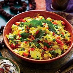 Indian Vegetable Cooking: Stir-Fried Cabbage with Red Pepper and Peas Recipe | CookingLight.com