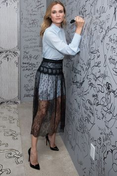 Diane Kruger in Valentino's lace layered over a striped shirt dress for a perennial work wardrobe