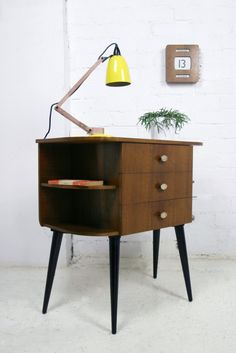 1950s bookshelf/chest of drawers. Wish I had this. So snazzy and such practical storage!