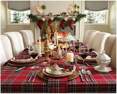 Plaid tablecloth and white plates.