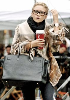 olsendaily:  Ashley wearing jacket by Alexander McQueen, Birkin bag by Hermes, and glasses by Oliver Peoples.