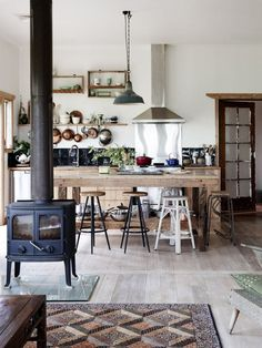 Tea's ready, everyone to the rustic farm kitchen table!