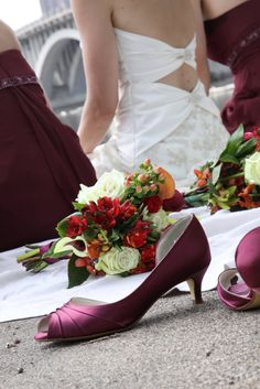 Maroon Bridesmaid's shoes & flower arrangements + back of wedding gown http://www.denisemackphotography.com/#!/DMP_Home