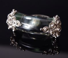 https://www.cityblis.com/2069/item/8661 | OR18 - $250 by Mademoizelle Sefra jewelry | Mademoizelle Sefra's Jewelry Ring in 925 sterling silver and crystal  Stone : obsidian crystal Dimensions : 4,5 cm wide | #Rings