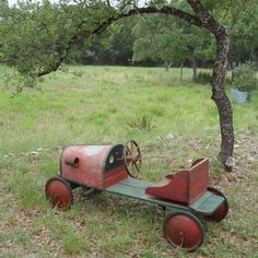 Abandoned relic from a long ago Soap Box Derby. This hand crafted piece of a youngster from the past could have been a race winner!  Achie  @Giftkone
