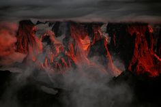 """Stronghold In Flames by Alexandre Deschaumes. This was a very powerful light coming on the chamonix needles for just 5 minutes . This light surprised me while I was backpacking at the summit of """"Mont Buet"""" 3100 m in the french alps . A very good memory . Alexandre Deschaumes, Stage Photo, Asajj Ventress, Munier, Chamonix, Morgoth, Anakin Skywalker, Greek Gods, Character Aesthetic"""