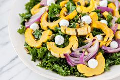 In this Massaged Kale Salad with Roasted Squash, Goat Cheese, and Pepitas kale is lightly massaged with olive oil, salt and pepper, before being tossed with roasted delicata squash, roasted red onions, herbed goat cheese, and pepitas.  When I hosted Thanksgiving this past November, I decided to experiment with my friend Becca's Massaged Kale Salad. Typically it features a lemon-y vinaigrette, fresh mangos and dried blueberries. It is pretty simple, but it is all about the method. The act of…