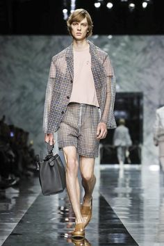 Business boys à la Fendi by Stefano Roncato - MFFashion We're lost in music. A remix of the iconic piece by Sister Sledge fills the room from the walls to the marble Fe...