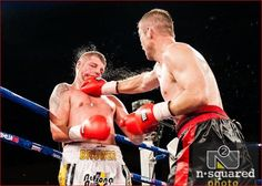 Smashed in the face. Danie Venter lands a blow against Daniel Bruwer at South Africa's Super8 boxing competition