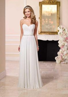 Stella York 6096 Wedding Dress // sheath dress that flows nicely from the hips, fitted through the bust (it's strapless, but overall shape could be good for what you're describing)